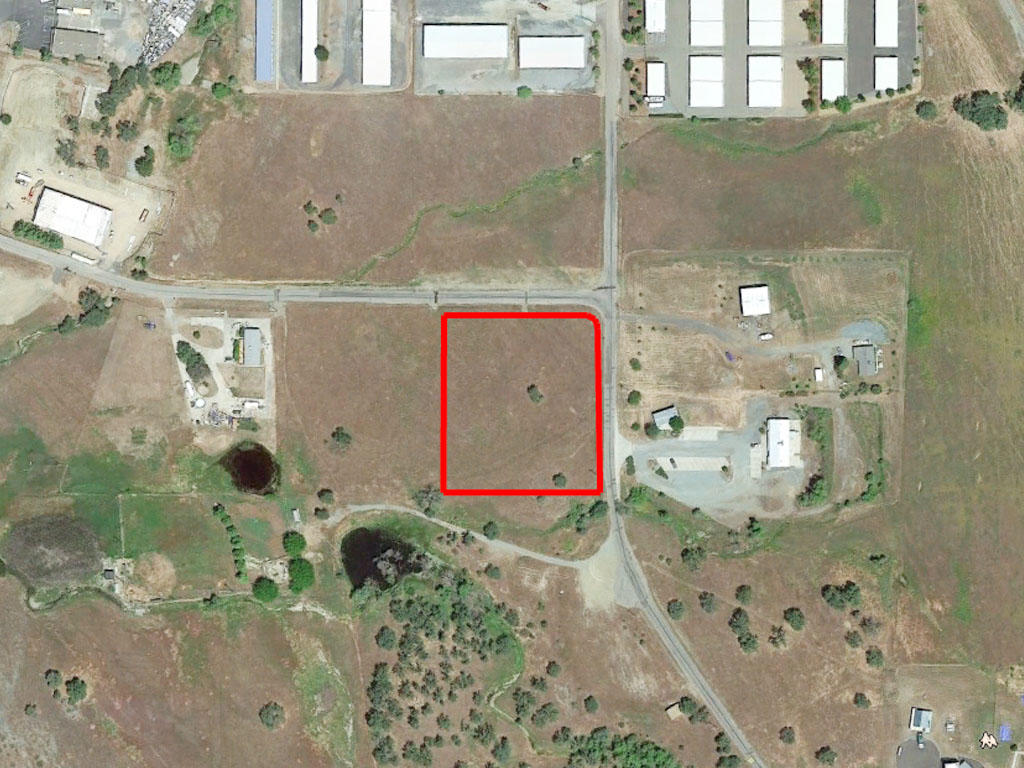 Unique Two Acre Corner Lot With Multiple Zoned Uses - Image 1