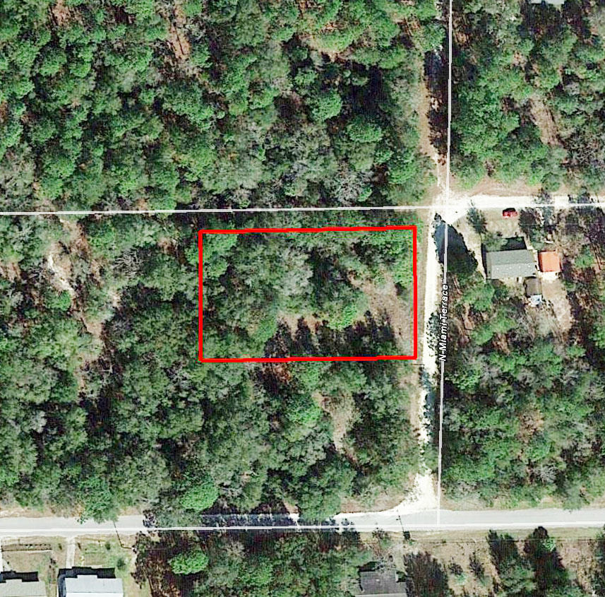 Large Lush Lot In Up and Coming Development - Image 1