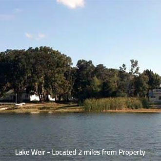 Property Near Lake Weir in Established Residential Area - Image 0