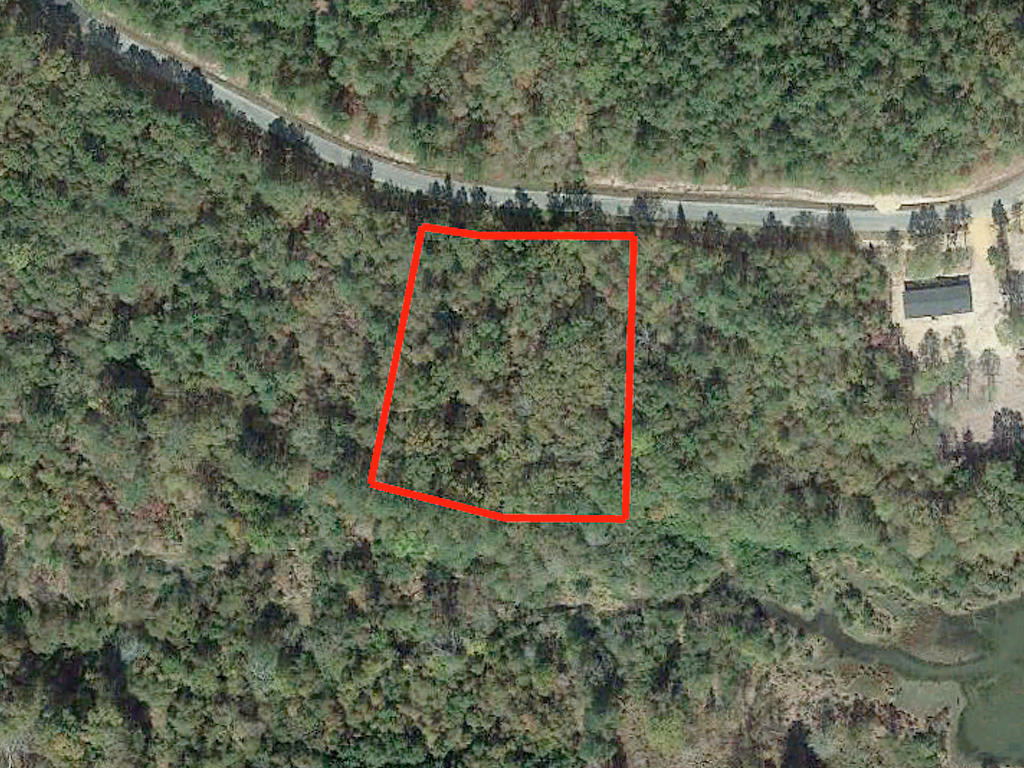 Gorgeous 1 Acre Lot with a Gentle Creek - Image 1