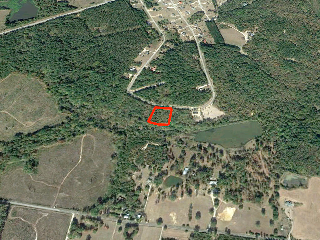 Gorgeous 1 Acre Lot with a Gentle Creek - Image 2