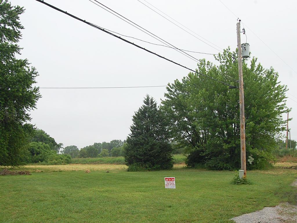 Unique Acreage in Bustling Community - Image 3