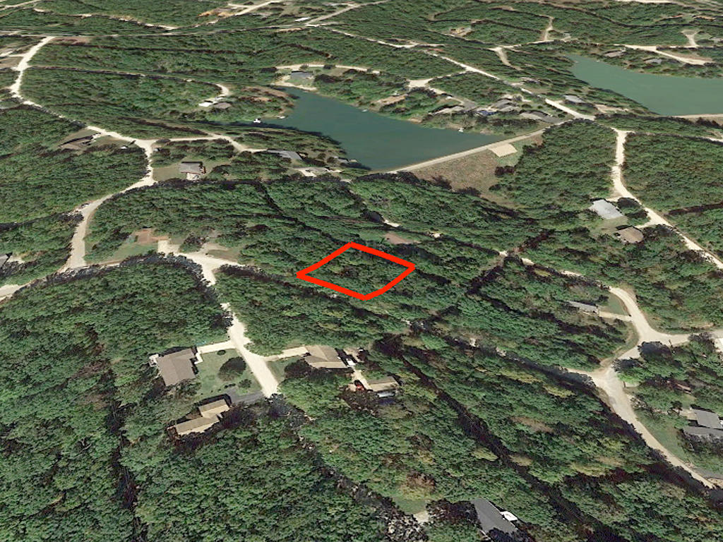 Treed property surrounded by lakes - Image 3